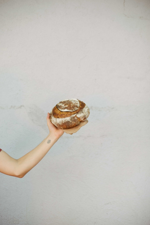 Jimena-Peck-Denver-Lifestyle-Editorial-Photographer-Daniel-Gray's-Sourdough-Bread-Hands-Bread