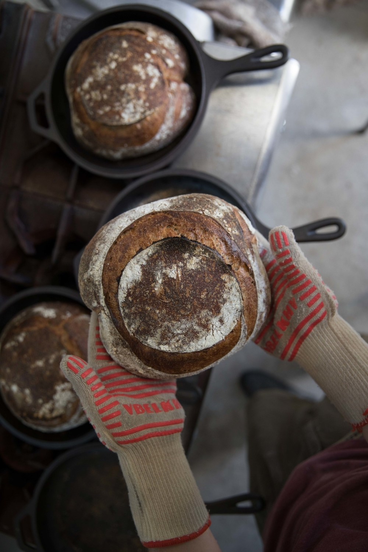 Jimena-Peck-Denver-Lifestyle-Editorial-Photographer-Daniel-Gray's-Sourdough-Bread-Gloves-Holding-Bread