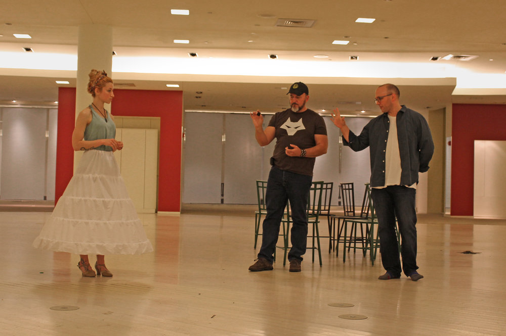 Director Brandon Bruce (right) works with actors Kelly Connaughton (Queen Anne) and G. Dwayne Johnson (Cardinal Richelieu).