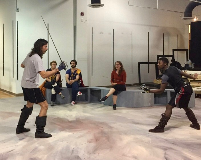 Hatcher (right) rehearses his duel with Athos - played by Steven Sullivan - as Fight Director Alexis Black (center) looks on.