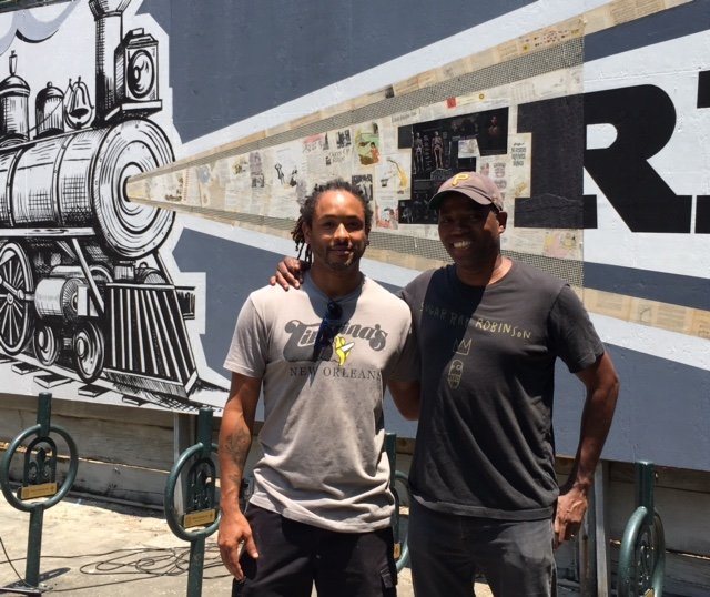 New Orleans artist Ayo Scott joins Cey Adams at mural unveiling ceremony, May 15, 2018.