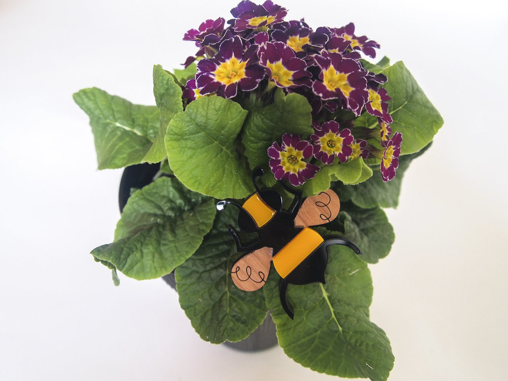 Carrying on with our Spring theme, these primroses are a lovely present for mums who prefer longlasting plants. Hide a bee brooch among the foliage as a surprise!  Flowers: Thimble Brooch: Laura Danby