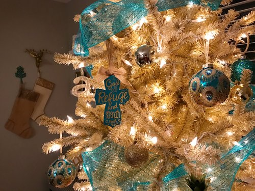 in addition to my gold and turquoise tree i found this beautiful peacock themed wreath for my front door and holiday stockings from kirklands that i hung