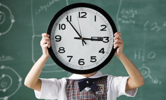 student with clock.jpg