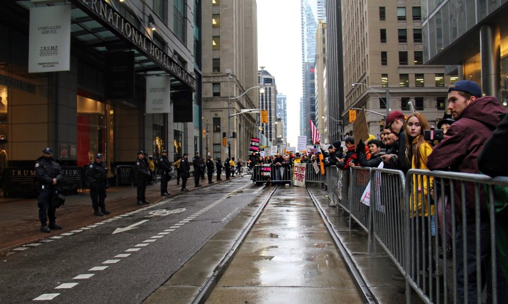 A barricade divides protestors and police at the Trump International Hotel and Tower on Saturday.