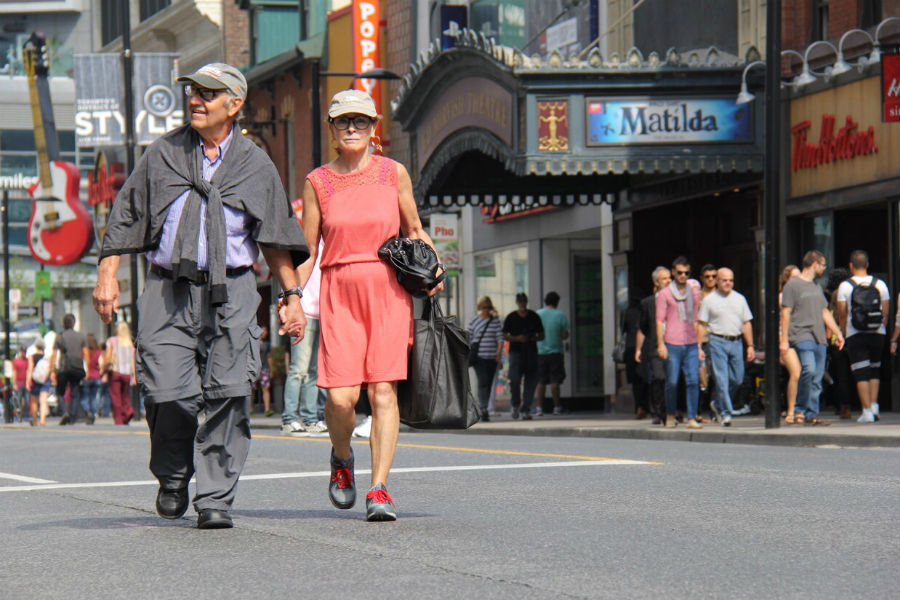 Malcolm Alexandroff and Marlene Fine walk hand-in-hand while enjoying Open Streets Toronto Sunday.