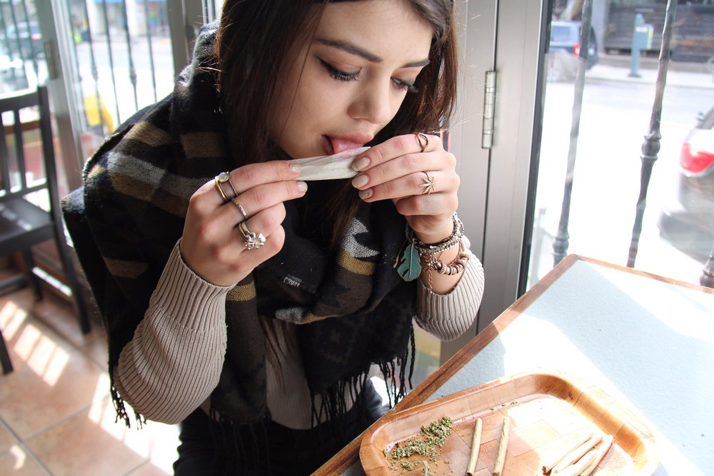 Emilie Walsh, an employee at Cannabis Culture's Church Street location, prepares a joint on Mar. 8, 2017.
