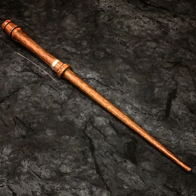"A special custom order Black Walnut Wand with silver leafing. It's always a challenge when doing a custom order, namely the worry that what you make won't be the vision your patron has in their head. But there's no better feeling after all the stress, mess ups, imperfections, and many many swears than when the customer tells you ""That's..... that's my wand, that's as designed, drawn, i'm speechless. HAPPY speechless!"" As any Wandmaker will tell you, these are the moments we live for. And now this one will soon be headin to England! * ** *** #centralcurios #wand #wands #wandmaking #wandmaker #wood #woodworking #woodworker #woodcarving #carving #exoticwood #harrypotter #handmade #blackwalnut #silverleaf"