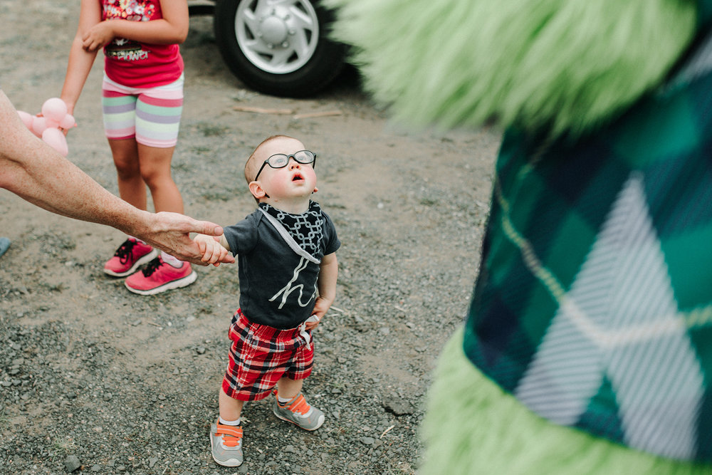 July 21: Speaking of wonder... what about seeing a mascot for the first time? Also, toddlers in glasses. Gah.