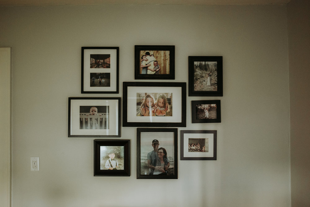 August 16: Finally getting photos on the wall. Making our house home more and more by the day.