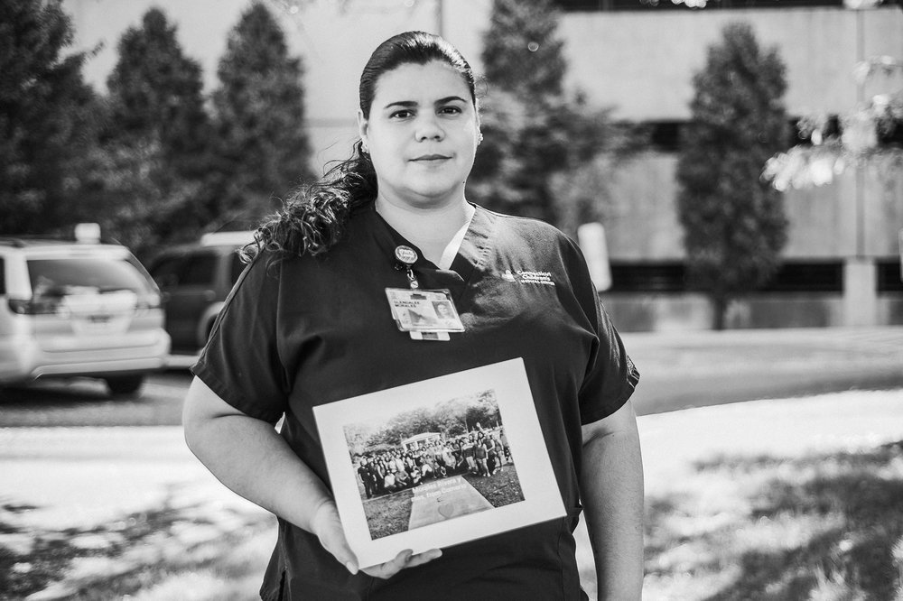 September 27: Connecticut has a large Puerto Rican population, and I photographed my friend Glenda and some other Puerto Rican co-workers holding photos of their families in Puerto Rico after Hurricane Maria devastated the island. I wanted to raise awareness and share their stories.