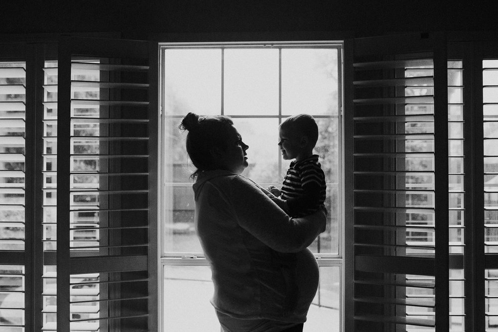 "February 21: ""I'll love you forever, I'll like you for always, As long as I'm living my baby you'll be."" -Robert Munsch  The next day Jameson became a big brother. I look at the photos I took on the eve of Maggie's brith and feel such tenderness for my nephew. It's a big change for such a little guy."