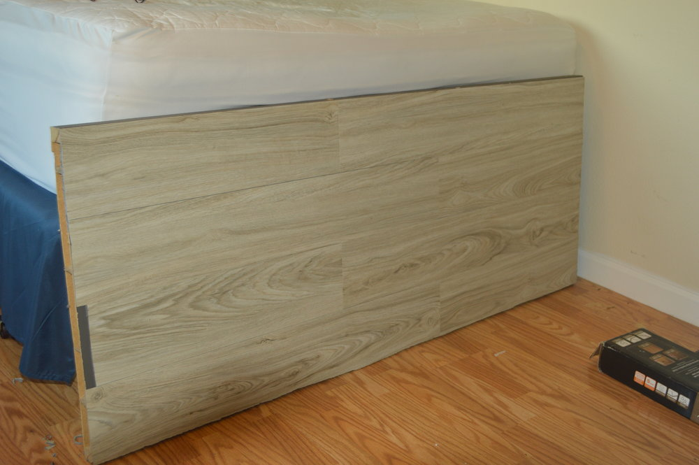 Allure flooring repurposed to headboard.JPG