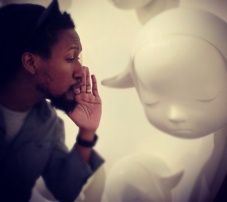 The artist having a quiet conversation with a sculpture by Japanese artist Yoshiomo Nara.