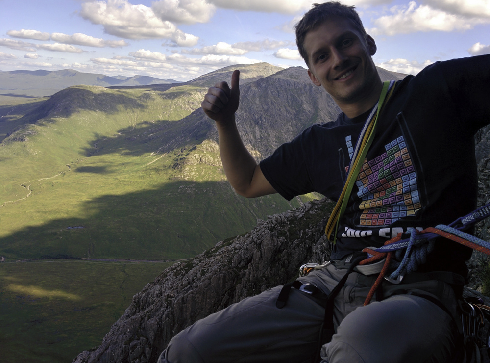 "Aaron takes in the view after climbing ""the Buckle"" (Buachaille Etive Mor) in Scotland. FYI, when people are coming down as you're going up, you should probably start the climb earlier!"