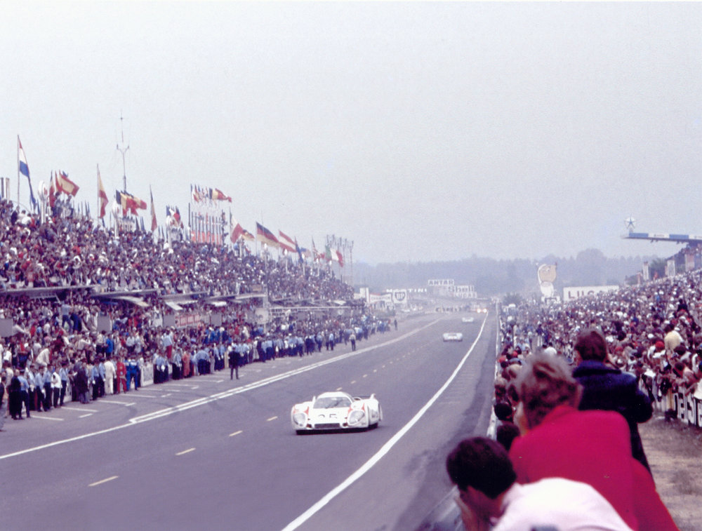 ?Quick? Vic Elford powers his long -tail Porsche 917K onto the front straightaway to lead lap #1 at the start of the 1970 Le Mans event.jpg