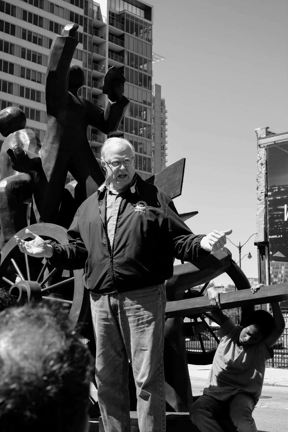 Rev. Tim Yeager told the crowd the short history of the Haymarket Square and its importance in the labor movements around the world while one the delegate's son hanging to the monument.  He spoke very passionately about the 8-Hour Workday movement when communist party members from all over the United States gathered at the Haymarket Square in Chicago that day.