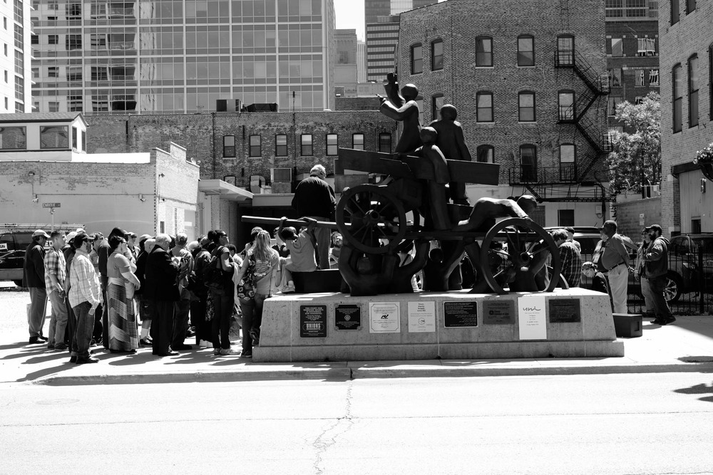 Small crowd of comrades listening Rev. Tim Yeager at Chicago's Haymarket Square.