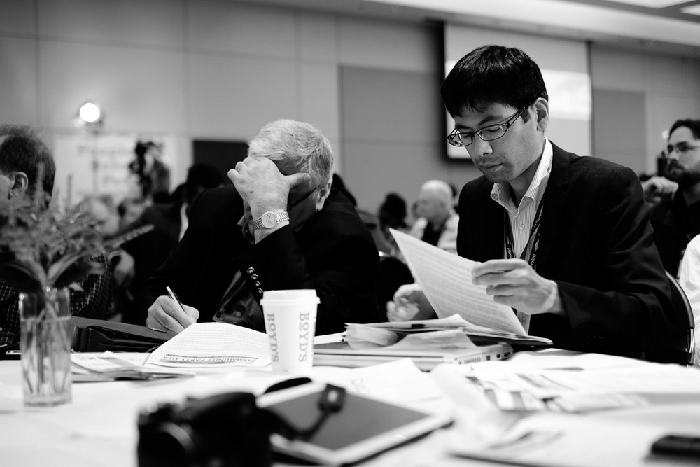 International guests from Iraq and Japan working on their notes.