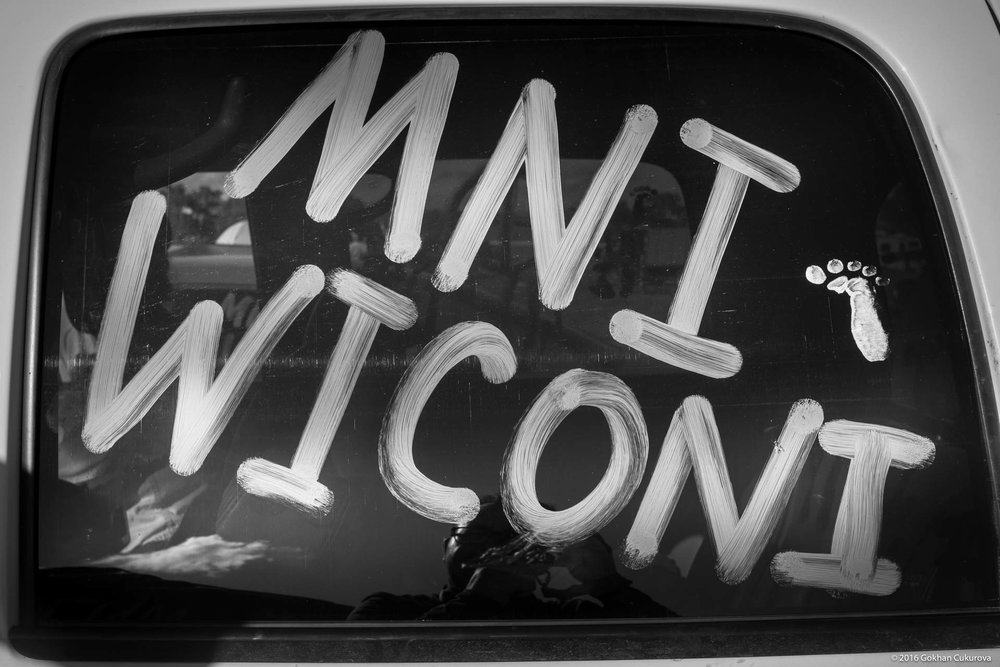 Mni Wiconi (pronounced Mini Wee-cho-nee) means Water is Life in Lakota language was written everywhere.
