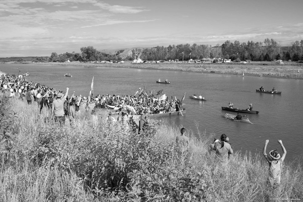 As the canoes pulled closer to the shore, the crowd got really excited