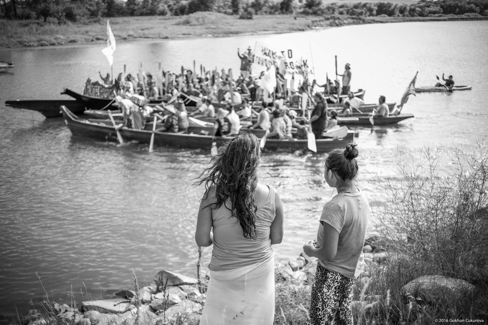 Mother and her daughter watching as tribes from many different states arrive in support of Standing Rock Sioux Tribe