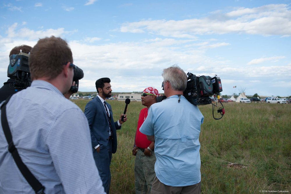 Hasan Minhaj of the Daily Show interviewing
