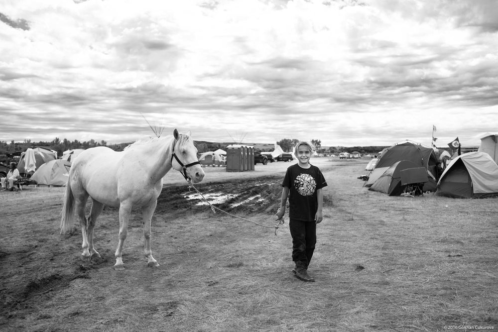Young boy walking his relative's horse.