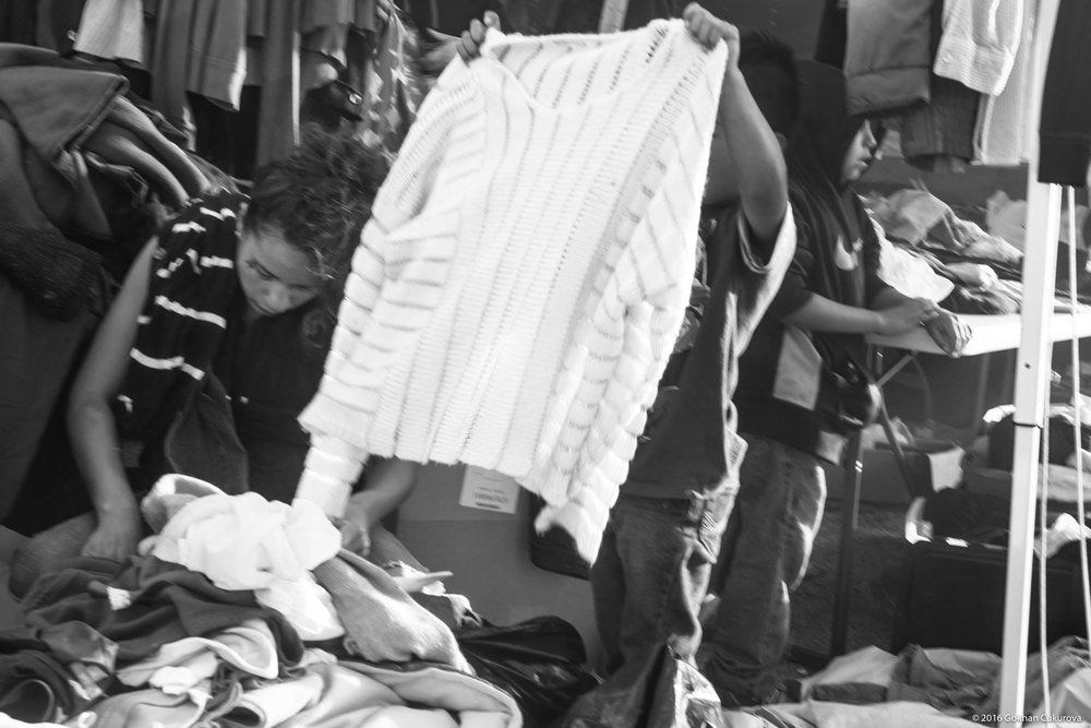 The donation camp was always busy. Children were among adults looking for warmer clothing.