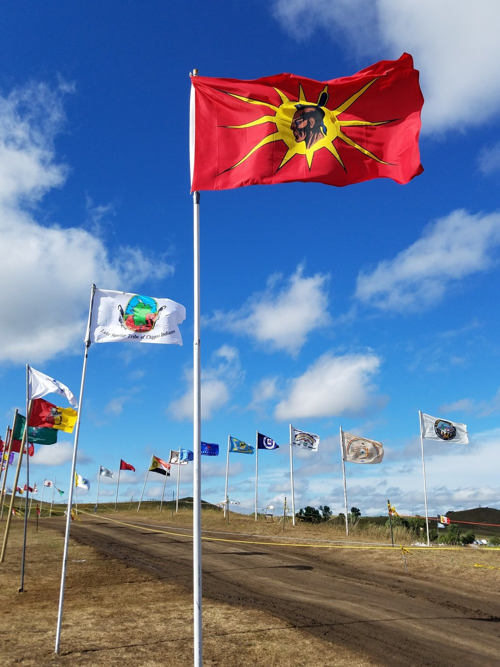 Avenue of the flags. This was the main entrance of the Red Warrior Camp. Each tribe brought a flag. They ran out of polls and used PVC pipes as the camp grew to a size of a small town!