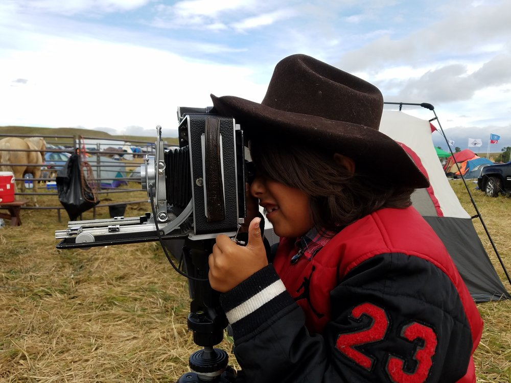 Teagun was pretending to take photos of his mother with my 4x5. He even asked his mom to be my assistant in the camp during my visit.