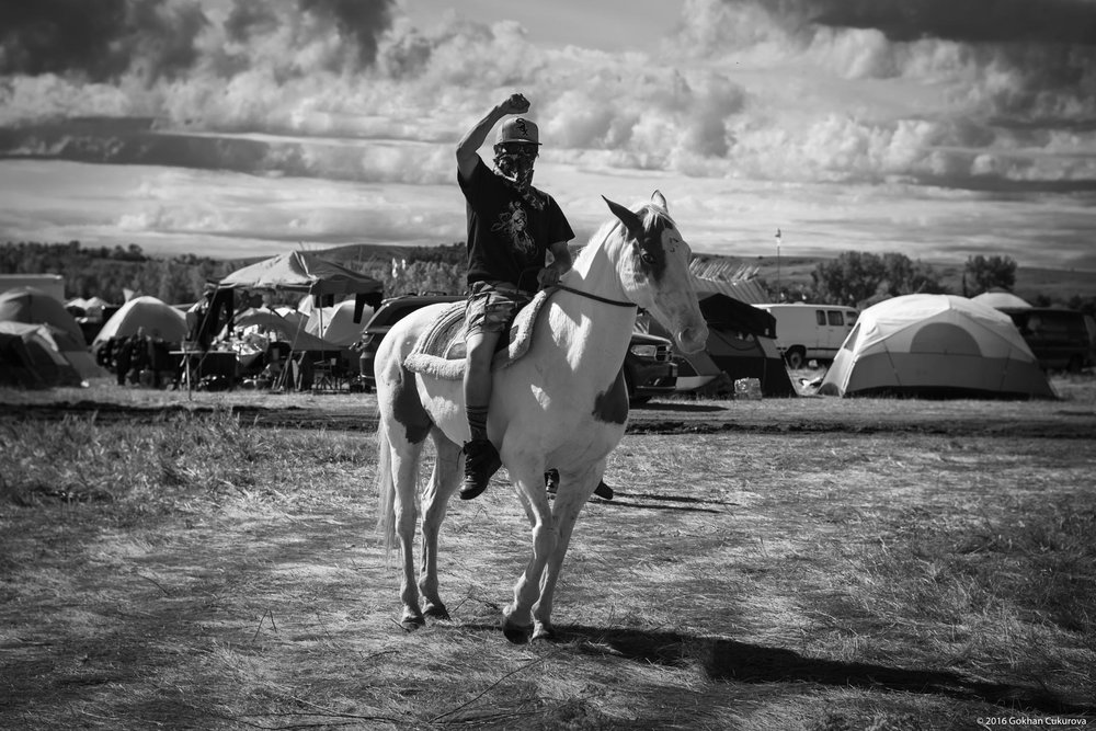 MJ, one of the masked warriors in the camp patrolling with his horse Champagne. Drugs/violence/guns strictly banned at the camp and it was very peaceful. There was so much praying and singing throughout my stay.