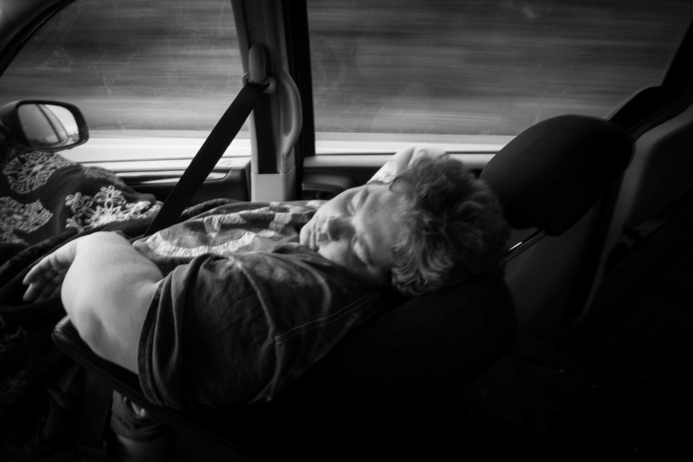 Heather takes a nap while her Aunt Jan drives her from the hospital in Jefferson City to Eldon. When they get to Eldon, they'll pick up Heather's children from school.