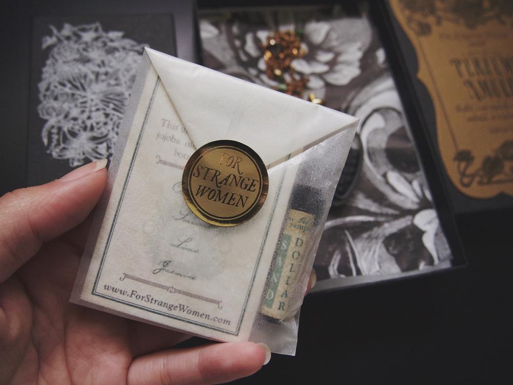 single sample vial of 'sand dollar'