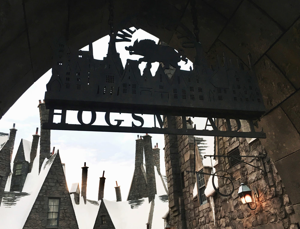 "a sign at one of the entrances to ""Hogsmeade"""