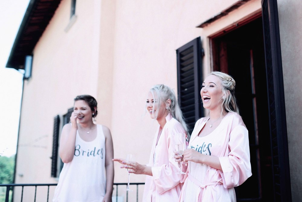 Bridesmaids laughing, Tuscany, Italy