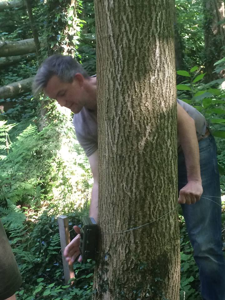 Dan Brown demonstrating setting up a camera trap in the field