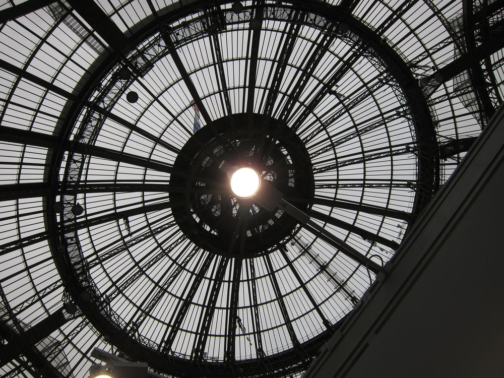 The Eye of Mammon shines over Paris Photo. It's much nicer since they moved the show from that subterranean warren under the Louvre to the Grand Palais.