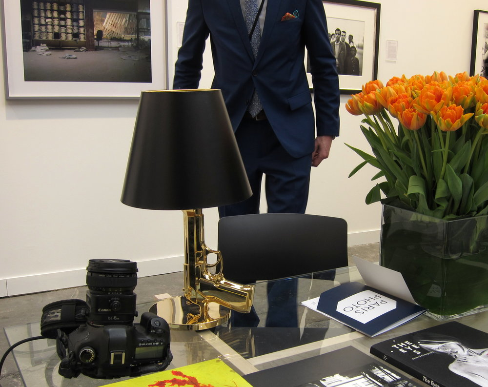 A tilt-shift lens, a snappy suit, and a gold-plated handgun are all useful when attending Paris Photo. Flowers are appropriate for any occasion. I had never seen the rather amazing photo by Sean Hemmerle back there on the left (or had I seen it and forgotten it? In which case there is no hope for me).