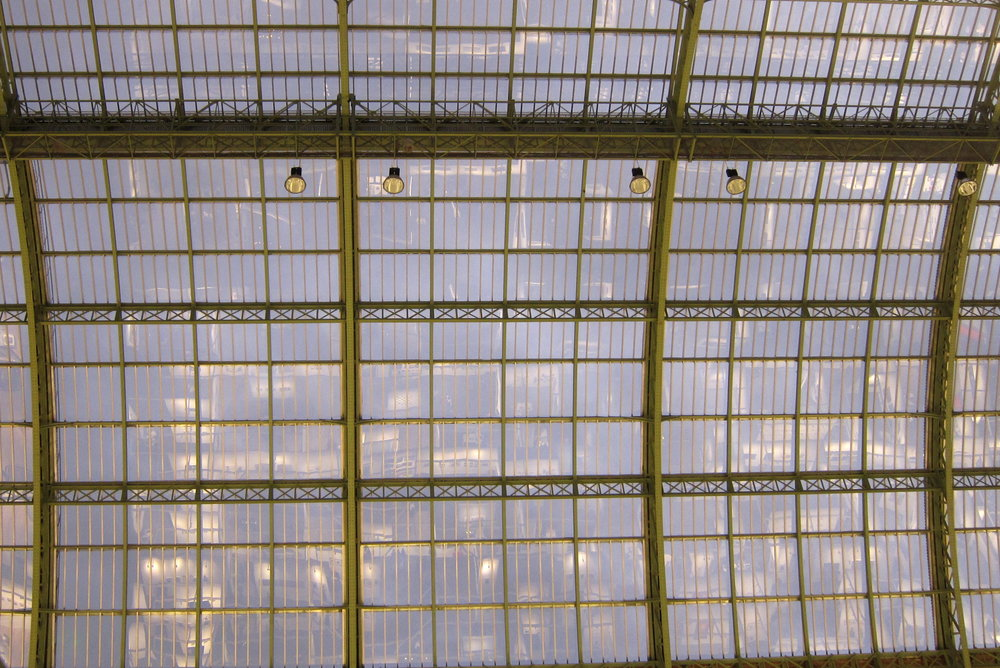 The glass ceiling of the Grand Palais reflects the stalls below. If I'd had a tilt-shift lens maybe I could have corrected the perspective distortion evident here. But I didn't, because I don't own one. Ditto a gold-plated handgun.