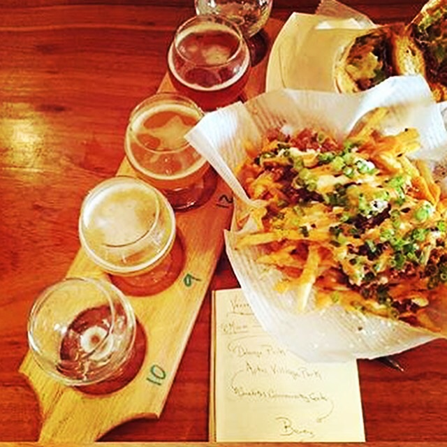 A perfect Pairing. Naughty Fries , Philly Cheese Steak and a Beer Flight from Corralitos Brewing Co. A ohoto posted by newly engaged couple doingtastings.