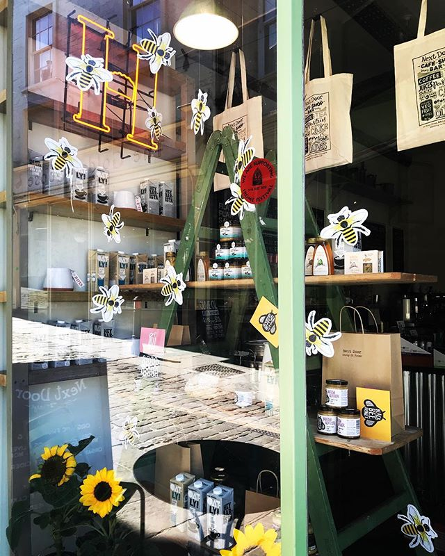 New Next Door window is in - buzzing about ethically harvested British honey #Frome #retail #window #windowdressing #independentstore #gardencafe #shopgirl