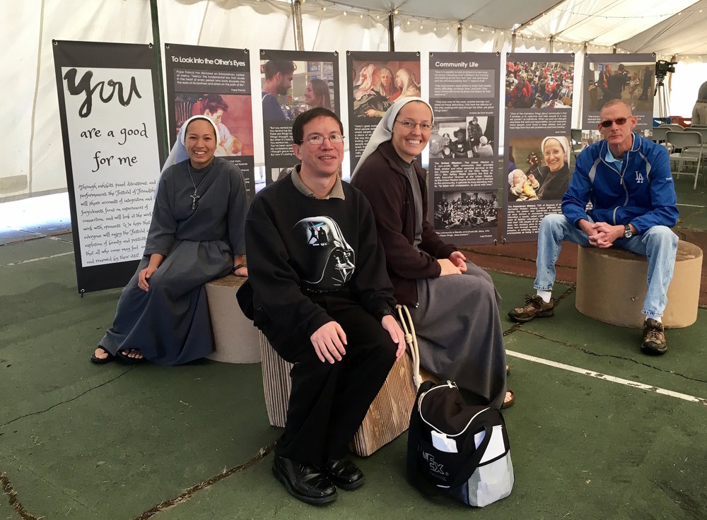 Sr. Philomena Clare, Jeff Zare, Sr. Rita Clare, and a friend all enjoy the exhibit