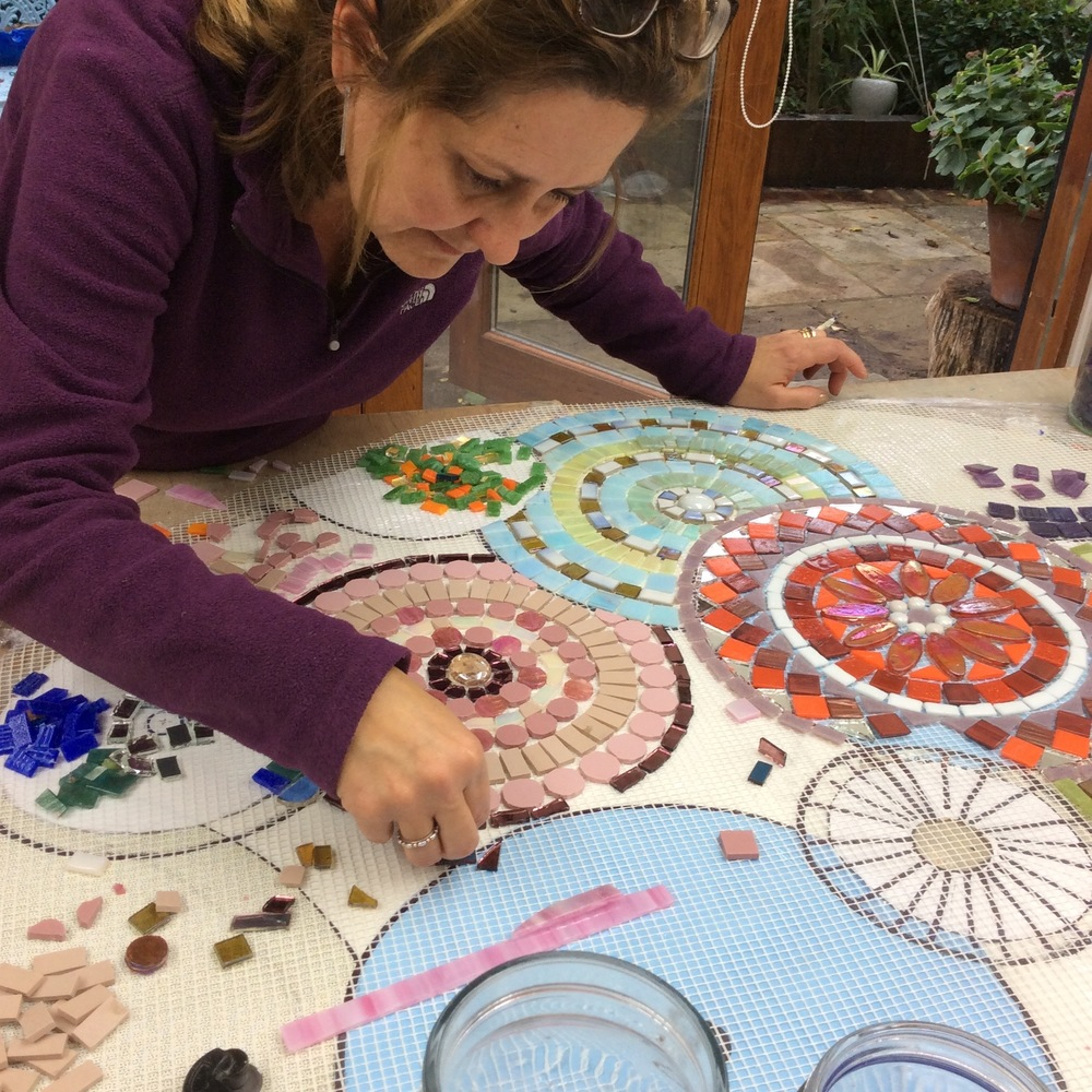 Patricia starting an ambitious table top using the direct method gluing tiles to mesh so when completed it could be easily transported to her family home in Columbia, Central America.