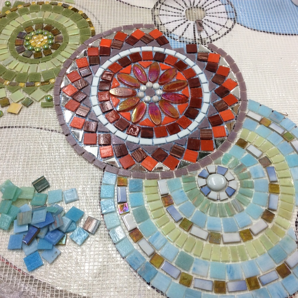 A simple design of overlapping circles made vibrant by the choice of glass and ceramic tiles and how the colours and textures are placed together to create both clarity and flow.