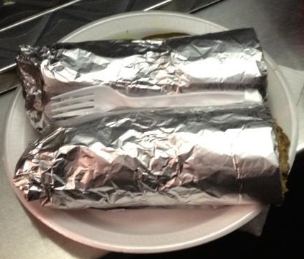 One monster Vaqueras burrito, cut in half, you know, to fit on a plate.
