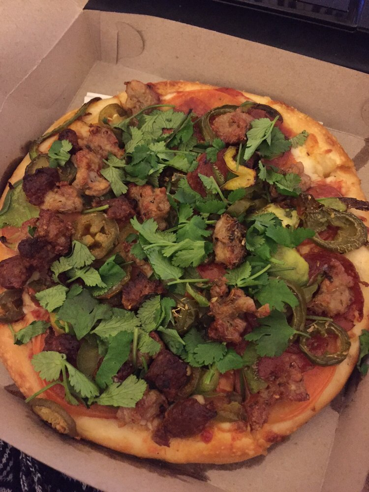 Mexican Pizza with chorizo, italian sausage, tomato slices, and cilantro..jpg