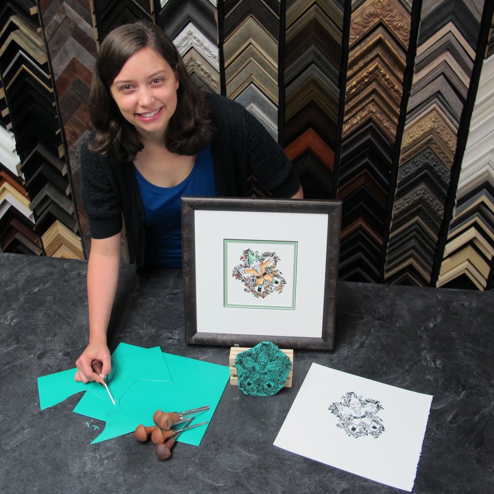 """Shelby Captured With Her Carving Supplies - Image Displayed: """"Gnome Angels""""Available in 3 colour selections each in a 1 of 25 series.Embellished with hand painted elements in watercolour.Original Print Professionally Framed For $149Available at The Framer's Gallery located in Port Perry, Ontario"""