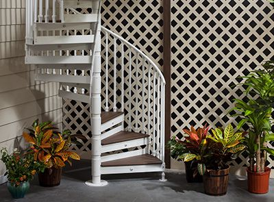 SPIRAL STAIRS Space-saving, customizable metal stairs solution for even the most challenging property lines and deck designs