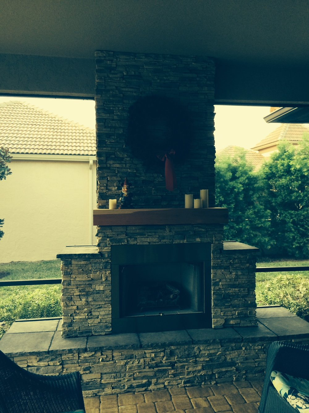 Optionally we can apply a stone tile over your outdoor kitchen (seen here on a fireplace, but same thing) We also offer custom grill islands, fire pits, fireplaces, fire tables, bars and everything in between.